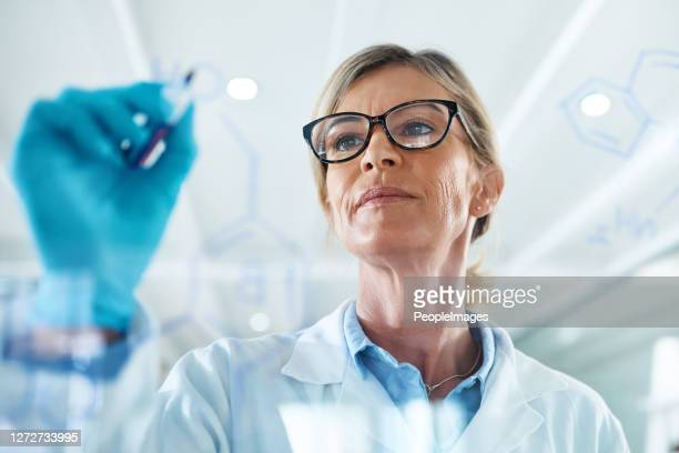 using empirical evidence and practicing logical reasoning - forensicpathologist stock pictures, royalty-free photos & images