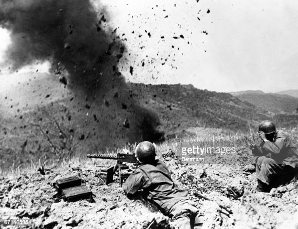 Using heavy satchel charges 38th division infantrymen blast out Japs from their positions in the Marikina watershed on Luzon Island, Philippines....