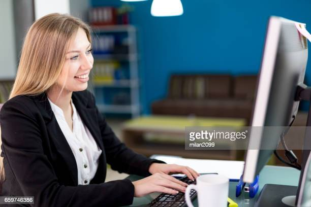 Using her computer in her office