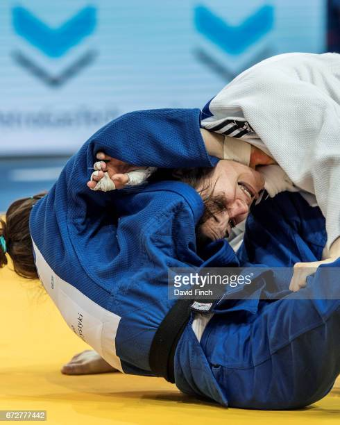 Using her opponent's jacket collar Helene Receveaux of France applies a strangle to Julia Kowalczyk of Poland causing her to submit by tapping...