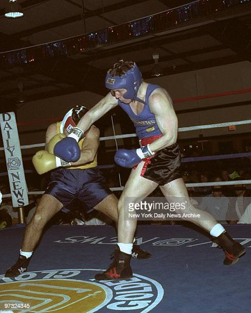 Using his head Omar Cor covers up as Jason Stern tries to land a left in Daily News Golden Gloves action Cor won the decision