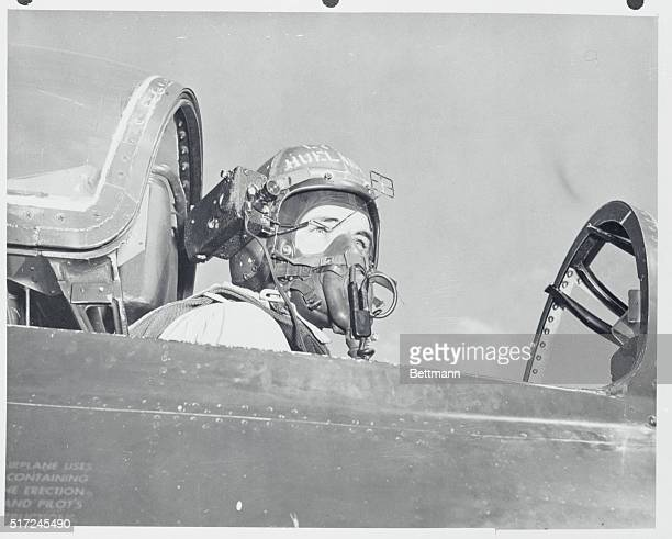 Using His HeadA camera mounted on his crash helmet enables St Louis Mo test pilot Gerald Huelsbeck to make movies without using his hands It was...