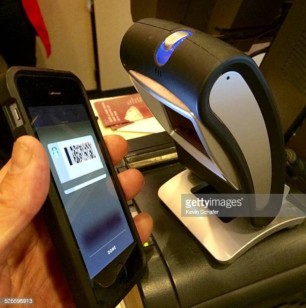 Using iPhone to pay for coffee at Starbucks Olympia Washington