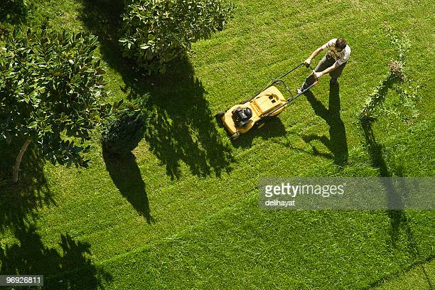 using lawn mower - tuinieren stockfoto's en -beelden