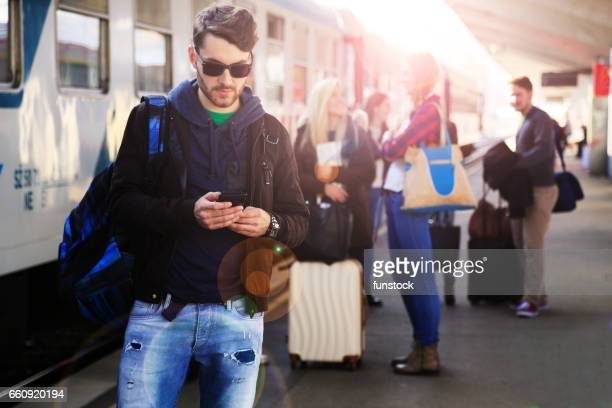 Using mobile phone on a train station