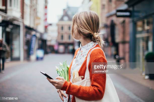 using mobile phone outdoors - utrecht stock pictures, royalty-free photos & images