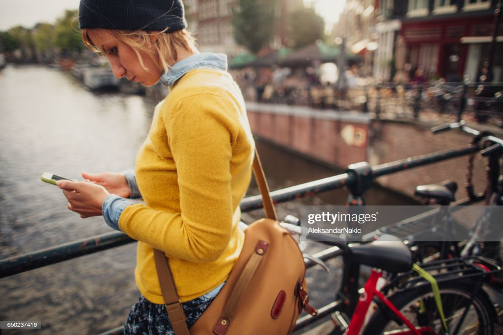 Using mobile phone outdoors : Stock Photo