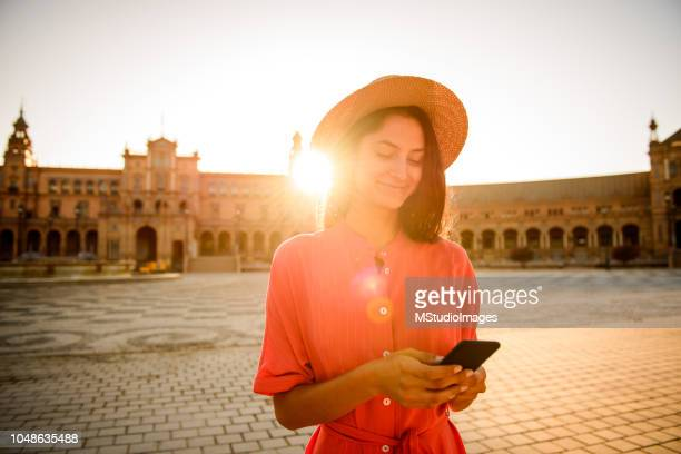 using mobile phone. - tourism stock pictures, royalty-free photos & images