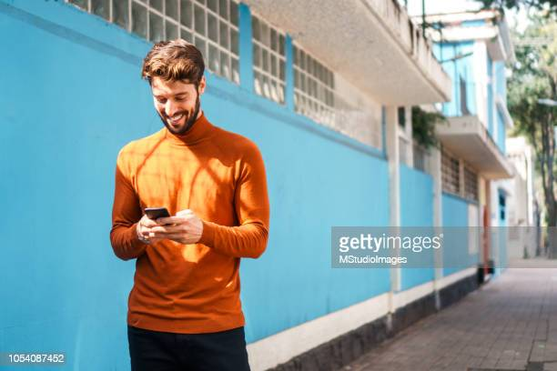 using mobile phone. - young men stock pictures, royalty-free photos & images