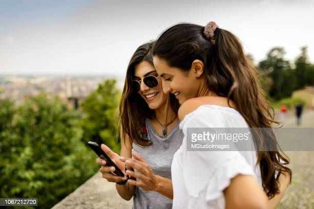 using mobile phone. - friendship stock pictures, royalty-free photos & images
