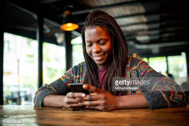 using mobile phone. - africa stock pictures, royalty-free photos & images