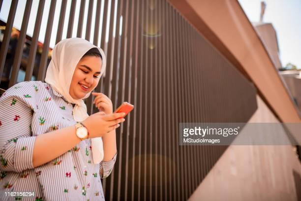 Using mobile phone.