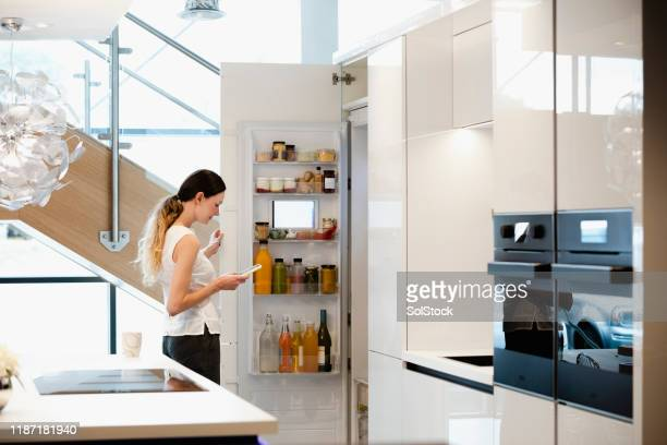 using my smart fridge! - smart stock pictures, royalty-free photos & images