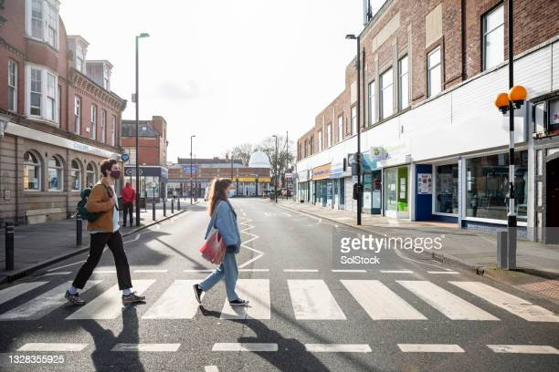 using pedestrian crossing safely - flatten the curve stock pictures, royalty-free photos & images