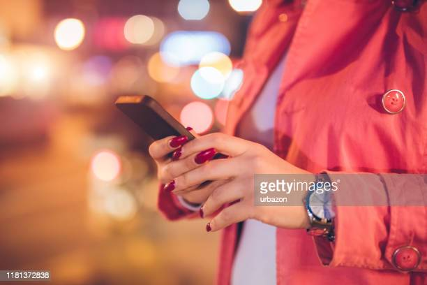 using phone downtown - phone message stock pictures, royalty-free photos & images