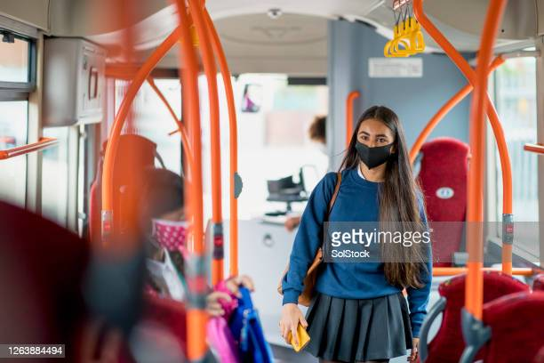using public transport during a pandemic - school child stock pictures, royalty-free photos & images