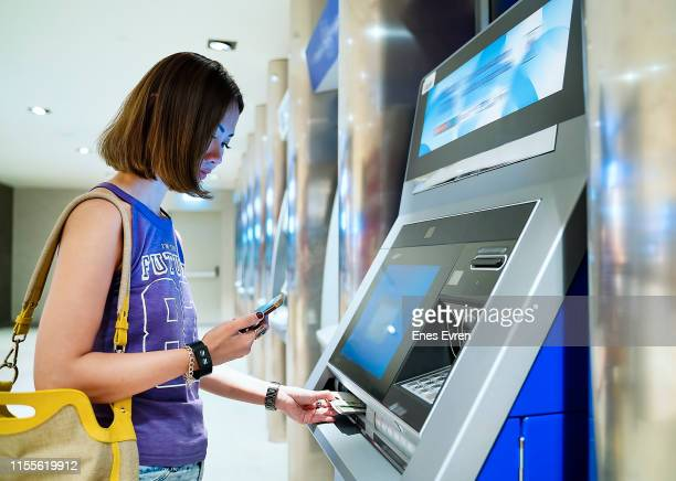 Using qr code by mobile phone, contactless withdraw money from cash machine