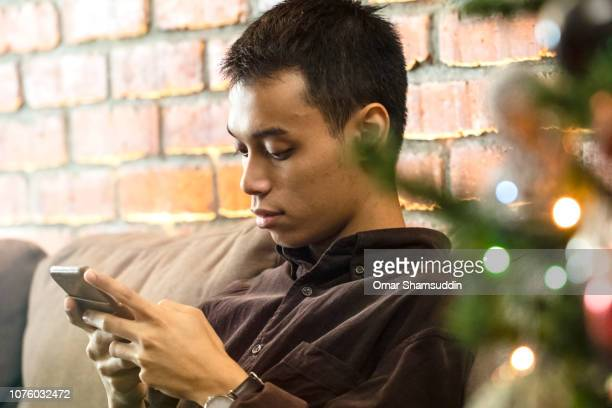 Using smart phone during Christmas at home