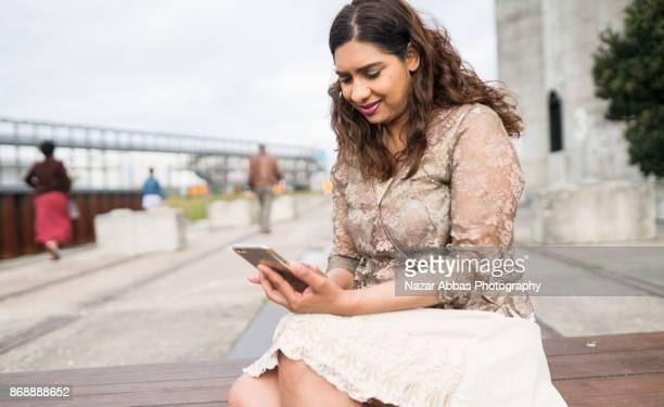 Using smart phone outdoor.