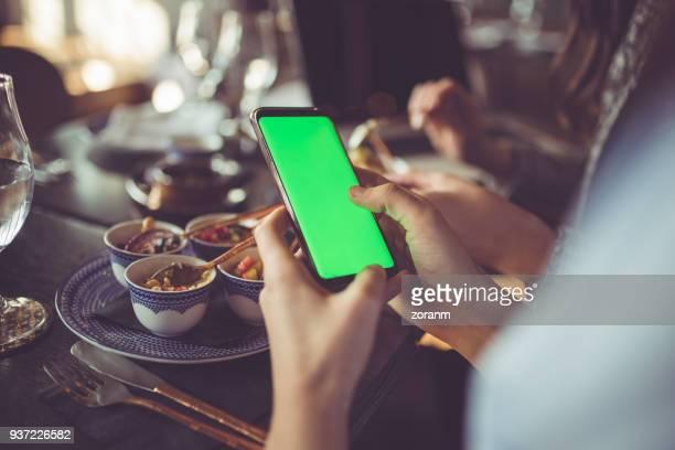 using smart phone with green screen - chroma key foto e immagini stock