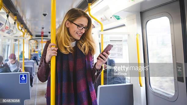 Using Smartphone on Her Way to Work