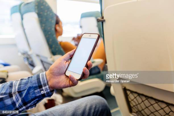 Using smartphone on the train