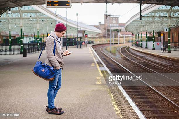 Using Smartphone While Waiting for the Train