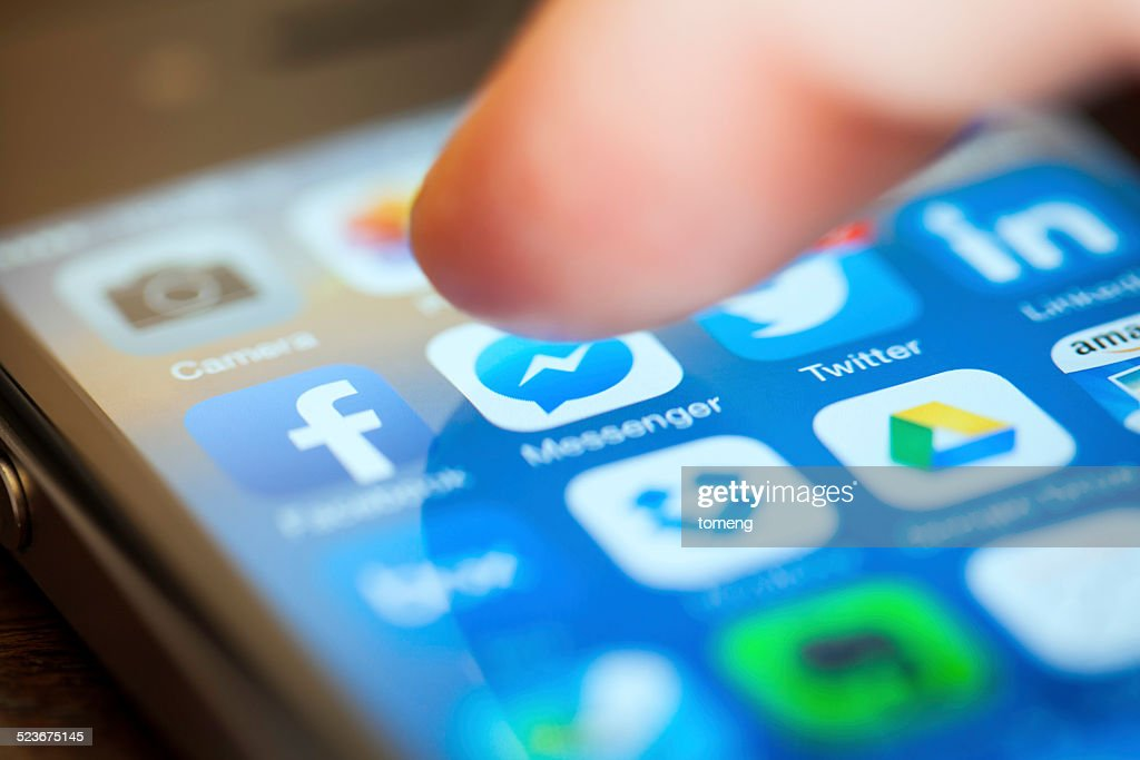 Using Social Media on iPhone : Stock Photo