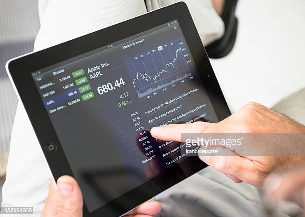 using stock market app with ipad 3 - apple computers stock pictures, royalty-free photos & images