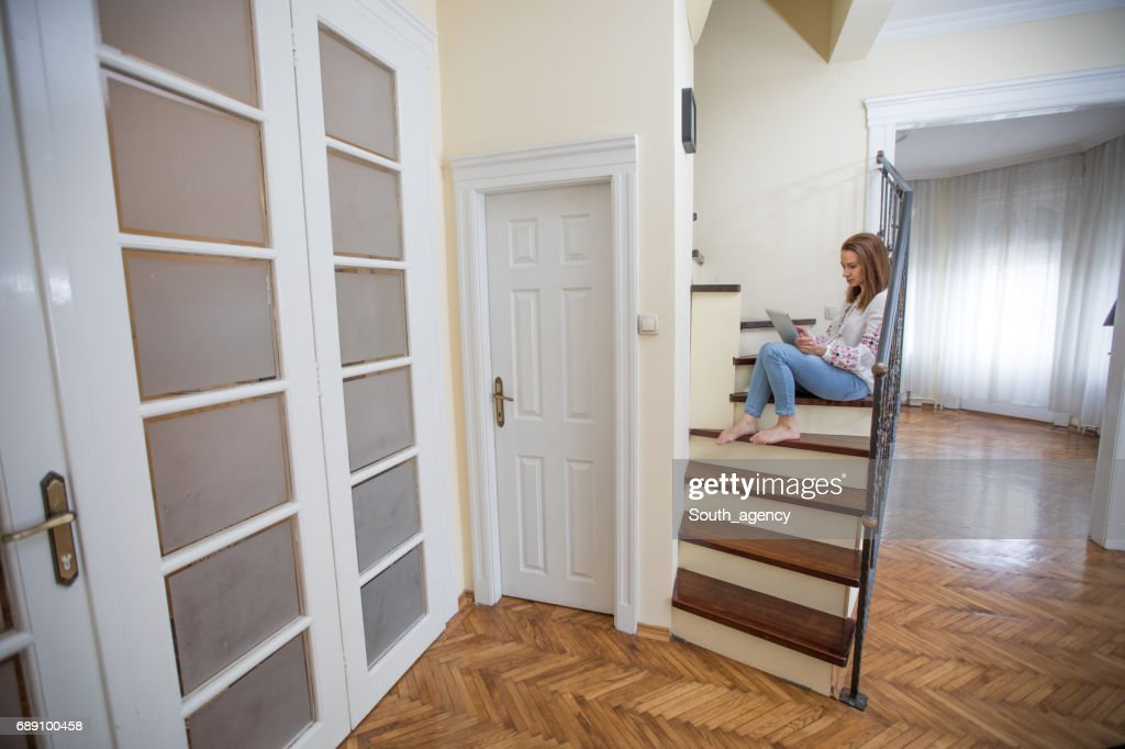 Using tablet on staircase : Stock Photo