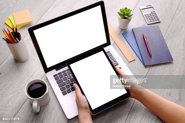 Using tablet pc and laptop on desk