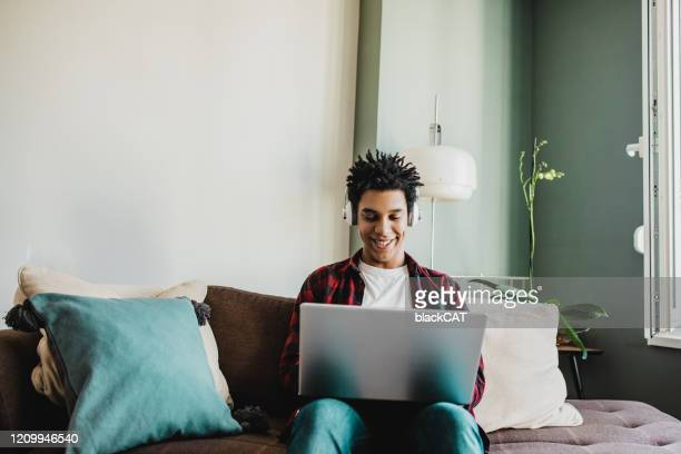 using technology at home - person in education stock pictures, royalty-free photos & images