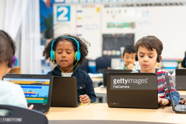 using technology in class - children only stock pictures, royalty-free photos & images