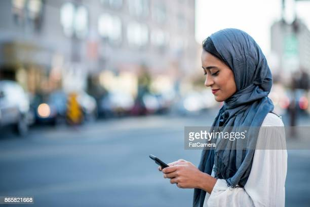 using technology - indian woman stock photos and pictures