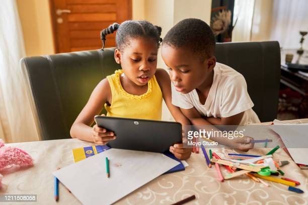 using technology to sharpen their young minds - africa stock pictures, royalty-free photos & images