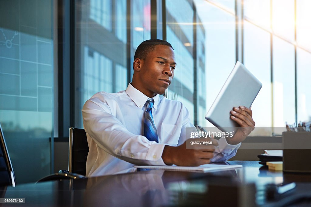 Using the internet to his advantage : Stock Photo