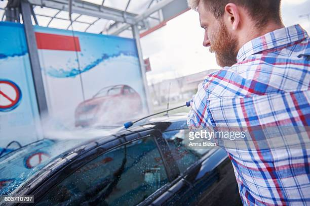 using the pressure washer is faster and cheaper. debica, poland - car wash brush stock photos and pictures