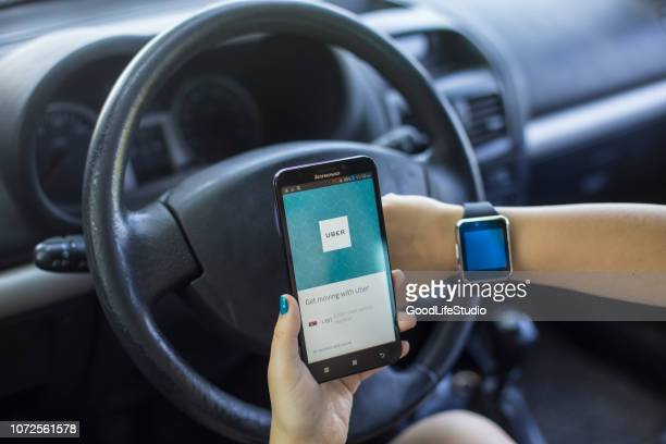 using uber app - lyft stock photos and pictures
