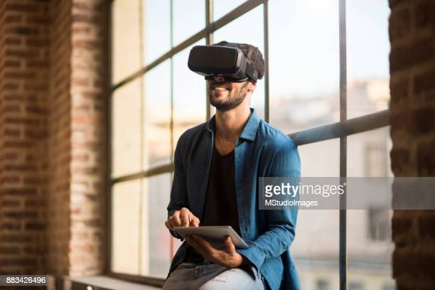 using virtual reality. - protective eyewear stock photos and pictures