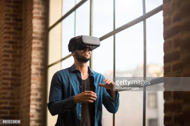 using virtual reality. - virtual reality simulator stock photos and pictures