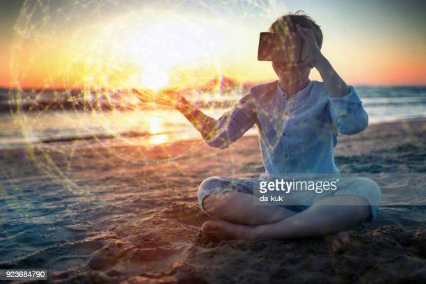 Using VR headset outdoors at sunset