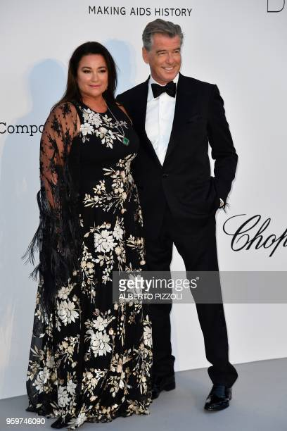 USIrish actor Pierce Brosnan and his wife Keely Shaye Smith arrive on May 17 2018 at the amfAR 25th Annual Cinema Against AIDS gala at the Hotel du...