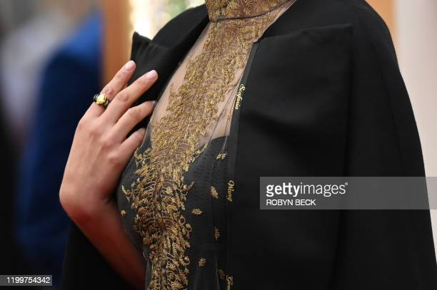Israeli actress Natalie Portman wears a cape with the names of female film directors who were not nominated for Oscars as she arrives for the 92nd...