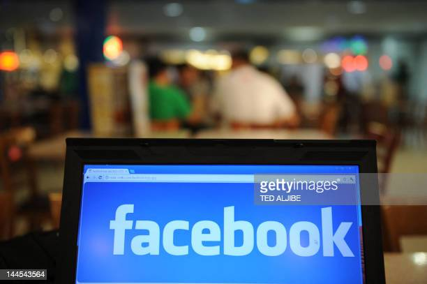 InternetIPOFacebookAsiaFOCUS by Dan Martin In a picture taken on May 15 a logo of social networking facebook is displayed on a laptop screen inside a...