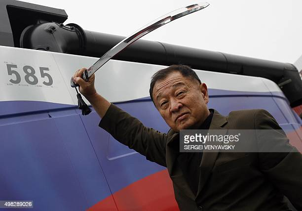 USJapanese actor CaryHiroyuki Tagawa poses with a sword during his visit to the Rostselmash grain harvester combines plant in RostovonDon on November...