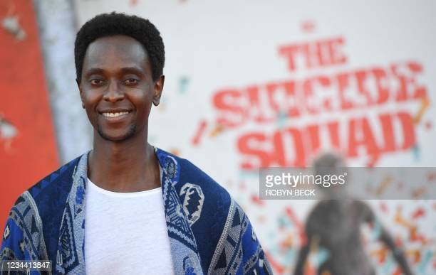 """Kenyan actor Edi Gathegi arrives for the premiere of """"The Suicide Squad"""" at the Regency Village theatre in Westwood, California on August 2, 2021."""