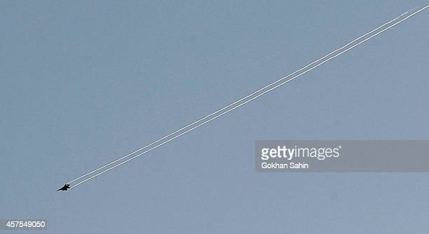 A USled coalition aircraft flies over Kobanii as seen from near the Mursitpinar border crossing on the TurkishSyrian October 20 2014 in the...