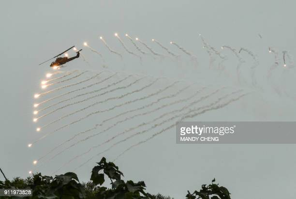 USmade AH1W Super Cobra helicopter launches flares during an annual drill at the a military base in the eastern city of Hualien on January 30 2018...