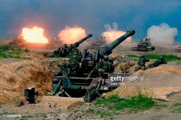 USmade CM11 tanks are fired in front of two 8inch selfpropelled artillery guns during the 35th Han Kuang military drill in southern Taiwan's Pingtung...