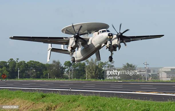 A USmade E2K air early warning 2000 aircraft takes off from a highway in southern Chiayi county during the annual Han Kuang drill on September 16...